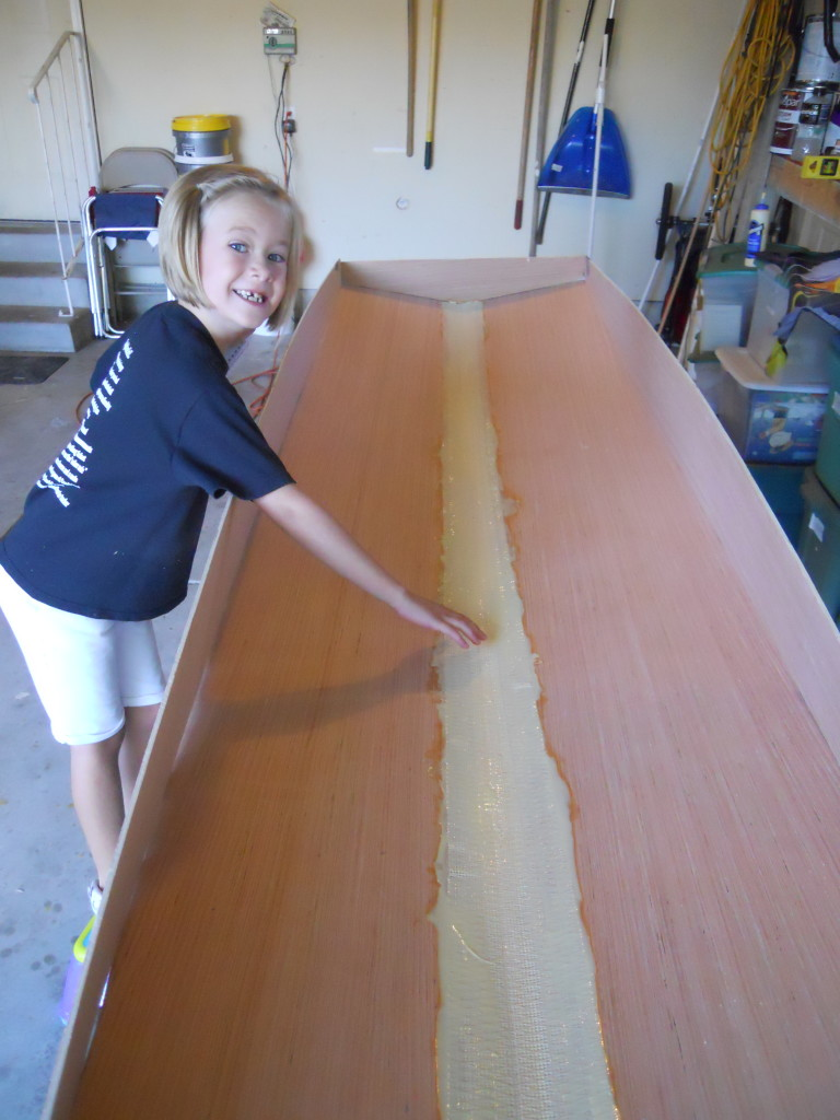 Here's Abigail helping me tape the panels together with Extra Strength Fibatape and Titebond II. If I were using epoxy she would not be able to help.