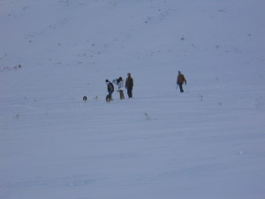 Boys trudging towards the sledding hill.