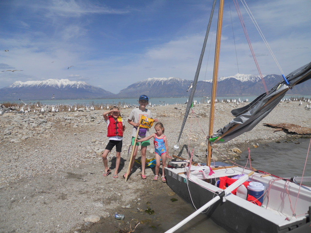 "Abby, Eliza, and Stella plant the ""Earl"" flag on Bird Island."